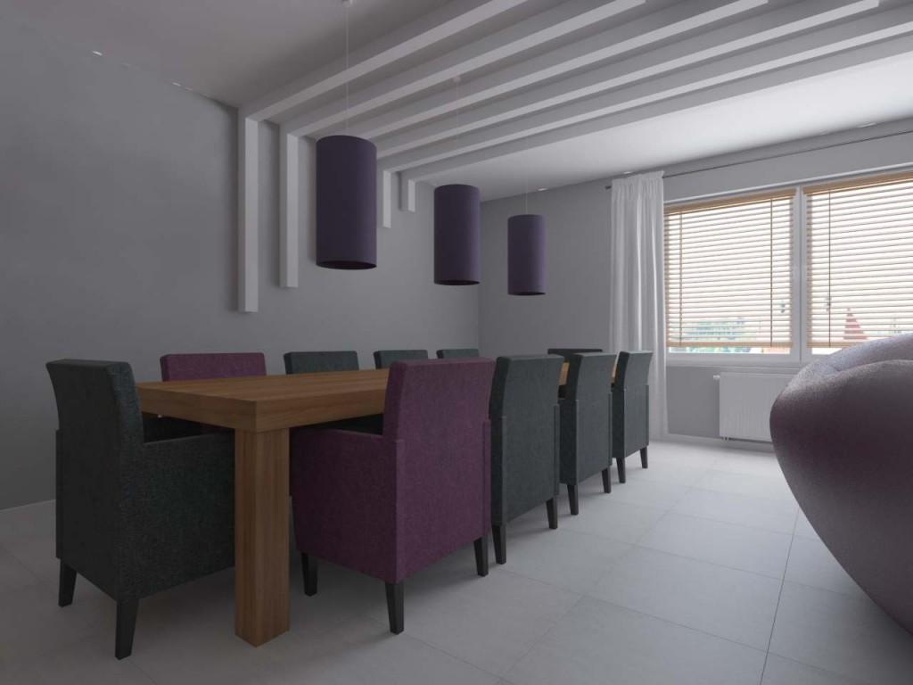 Długi, masywny drewniany stół w strefie jadalnej