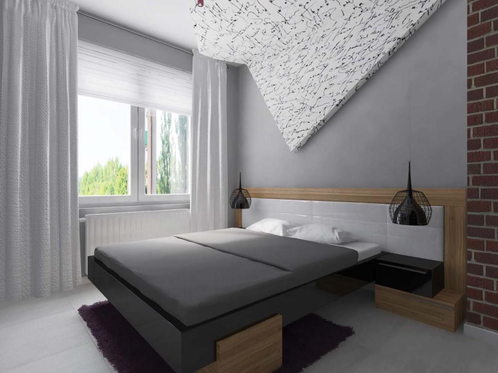 Widok na łóżko, które łączy dwie tekstury: czarny lakier oraz drewno